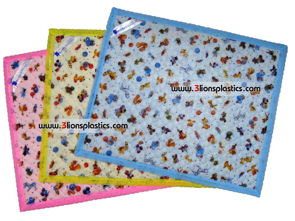 ผ้ายางติดริมลูกไม้ เล็ก- โรงงานผลิตผ้าพลาสติกปูรองที่นอนเด็ก